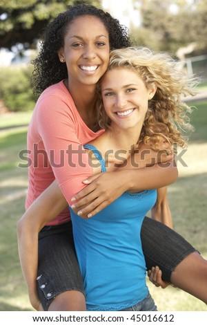 Teenage Girls Having Fun In Park