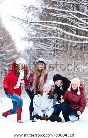 Teenage girls in warm clothing laughing