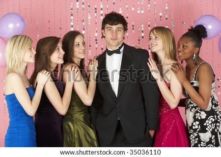 Teenage Girls Looking At Attractive Boy