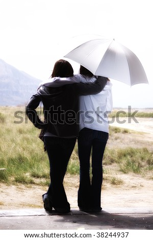Teenage Girls Looking Out the Door with an Umbrella