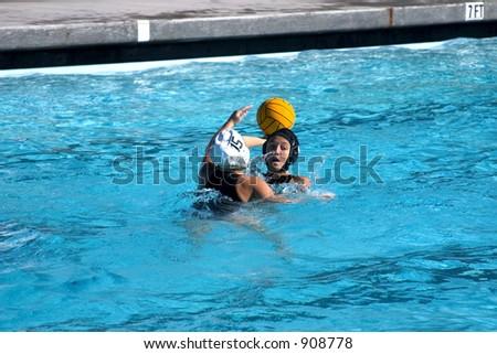 teenage girls playing waterpolo.