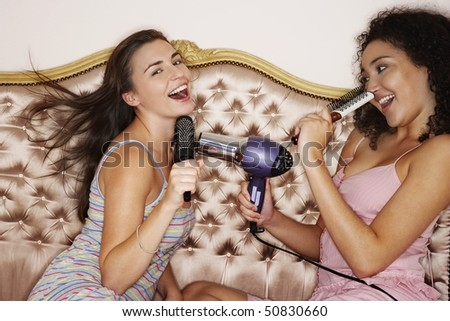 stock photo : Teenage Girls playing with brushes and hair dryer at slumber ...