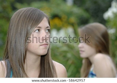 Teenage girls spend some time outside in the garden.