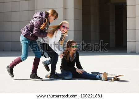 Teenage girls with skateboard - stock photo