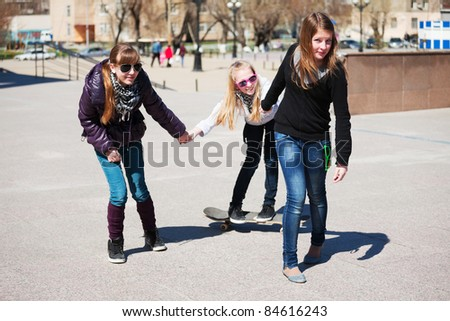 Teenage girls with skateboard