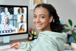 Teenage mixed race girl high school student distance e learning group online class at home looking at camera. Video conference call remote class, course, virtual digital education, headshot portrait.