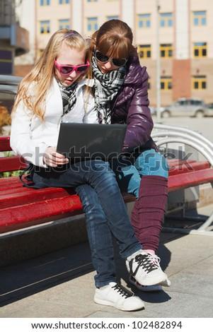 Teenage schoolgirls using laptop