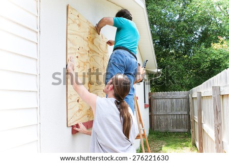 teenage son helping his father...