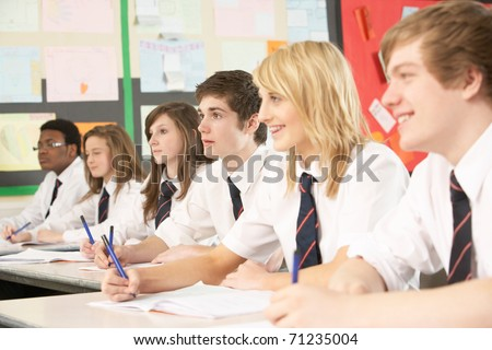 Teenage Students Studying In Classroom