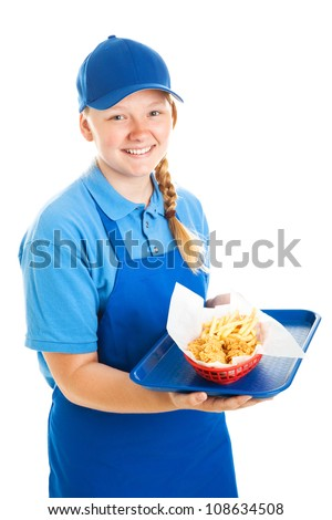 Teenage worker serving a fast food meal.  Isolated on white.