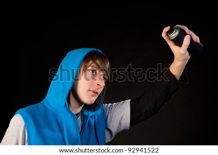 Teenager about to use a can of spray