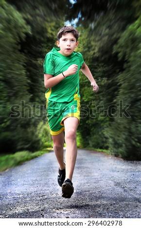teenager boy in sportswear run on the country road