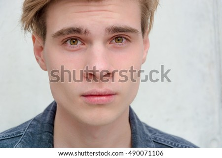 Teenager boy looking straight closeup serious expression - Shutterstock ID 490071106
