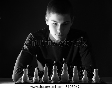 Teenager boy playing chess