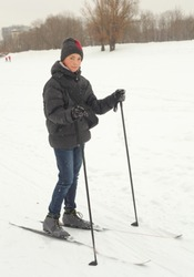 teenager boy skiing in the winter park