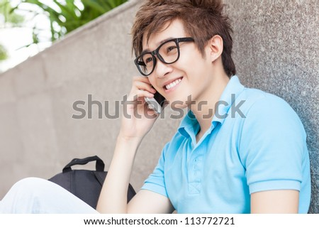 Teenager boy talking on the phone outdoors
