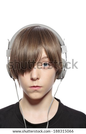 teenager boy with hair over one eye and headphones, isolated on white.