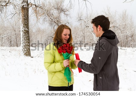 Teenager boy with Valentines Day gifts for his girlfriend.
