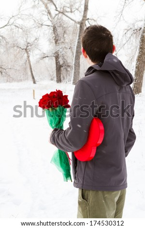 Teenager boy with Valentines Day gifts waiting for his girlfriend.