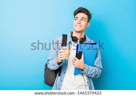 Teenager caucasian man ready to go to school