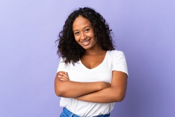 Teenager cuban girl isolated on purple background keeping the arms crossed in frontal position
