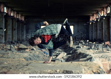 Teenager dancing break dance in the old brickworks