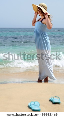 Teenager dreaming on tropical beach