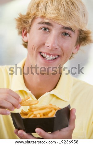 Teenager Eating Fries