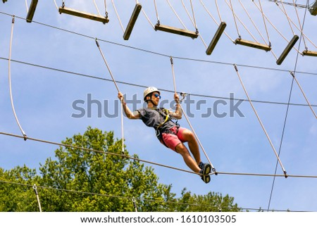 Teenager enjoying a sportive day in an adventure park.