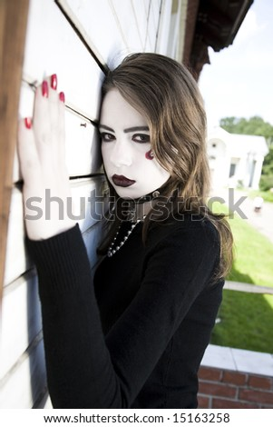 Teenager Female Goth Against Wooden Wall