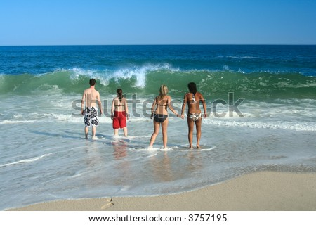 Teenager friends together at the beach.