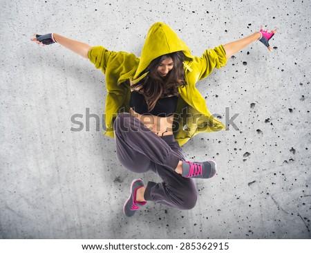 Teenager girl dancing hip hop over textured background Сток-фото ©