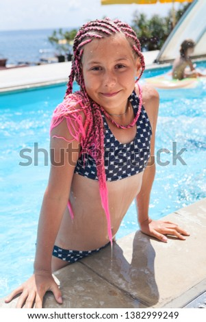 4cca56bea3b17 Teenager girl get out from swimming pool, dressed swimsuit and dreadlocks  on head #1382999249