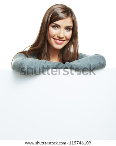 Teenager girl hold white blank paper. Young smiling woman show blank board. Close up female model portrait isolated on white background.