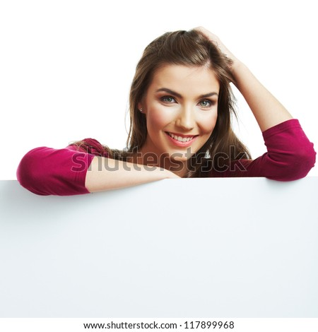 Teenager girl hold white blank paper. Young smiling woman show blank board. Close up portrait isolated on white background