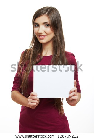 Teenager girl hold white blank paper. Young smiling woman show blank board. Close up portrait isolated on white background - stock photo