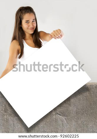 Teenager girl holding a blank banner