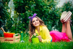 Teenager girl holding flowers pot. Young girl planting flowers in pot. Potted plant, potting concept