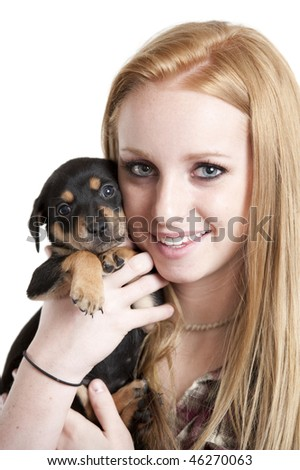 Teenager girl holding puppy dog. Image on white background