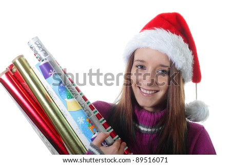 Teenager girl holds Rolls of Christmas gift Wrapping Paper