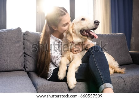 Royalty Free Happy Guy Sitting On A Sofa And Looking 499979860
