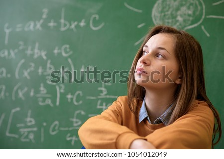 Teenager girl in math class overwhelmed by the math formula. Pressure, Education, Success concept. Foto stock ©