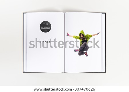 Teenager girl jumping in street dance style printed on book