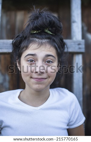 Teenager girl on a street in the countryside.