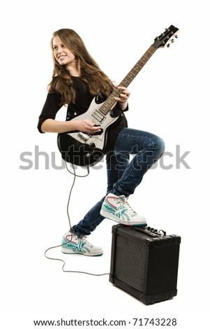 Teenager girl playing guitar against white background