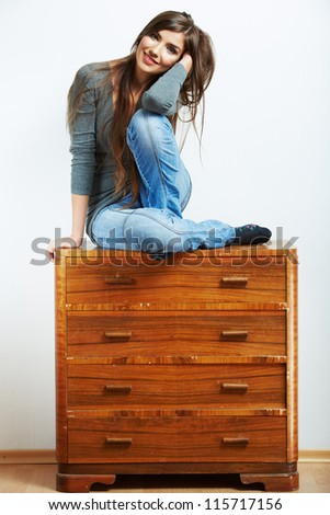 Teenager girl portrait. Young smiling woman seat at stock. Beautiful female model portrait