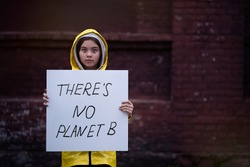 Teenager girl protesting climate change. Fridays for future