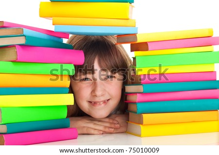 teenager girl sitting behind pile of books on white