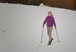 teenager girl ski in winter snowy park
