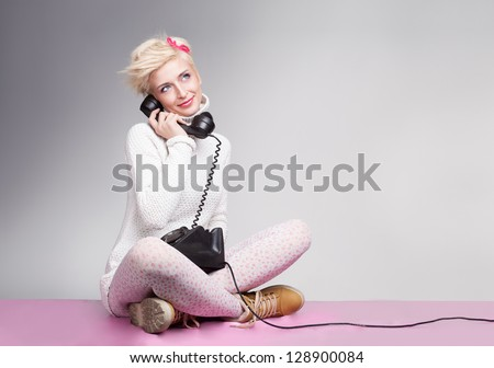 teenager girl speeaking with her boyfriend on the phone and smiling
